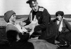 Maria and Anastasia with Dimitri Pavlovich, 1916