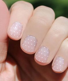 Swiss dots on nude nail background