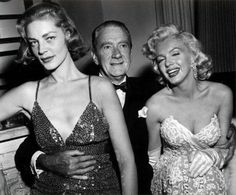 """Marilyn Monroe at the """"How To Marry A Millionaire"""" premiere after-party with Lauren Bacall and Clifton Webb, November 1953"""