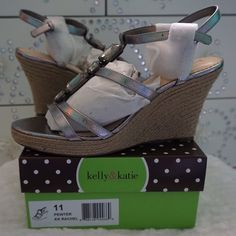 """NEW KELLY & KATIE RACHEL METALL SIZE 11 · BRAND NEW WITH BOX   · SIZE: 11 · DESCRIPTION: METALLIC FAUX LEATHER UPPER, UP THE FRONT JEWELS, ADJUSTABLE QUARTER STRAP, 1"""" PLATFORM, 3 3/4"""" ROPE COVERED HEEL, SYNTHETIC SOLE · COLOR: PEWTER METALLIC  ⭐️TOP RATED SELLER FAST SHIPPER NEXT DAY SHIPPING ❌NO TRADE ❌NO PAYPAL ✅BUNDLE OFFER Kelly & Katie Shoes Wedges"""