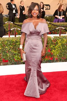 BEST: Viola Davis  Viola Davis wore this plum-colored Zac Posen dress, and though those oversized off-the-shoulder sleeves would overwhelm anyone else, Davis is working the architectural design in truly regal style. #SAGAwards