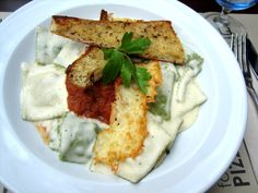 One of our new pastas, the wild mushroom ravioli! Sauteed in a garlic & tomato cream sauce