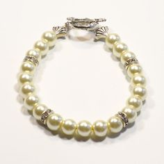 Check out IVORY Women's stackable bracelet, stacking bracelet, statement bracelet, beaded bracelet on dunglebees
