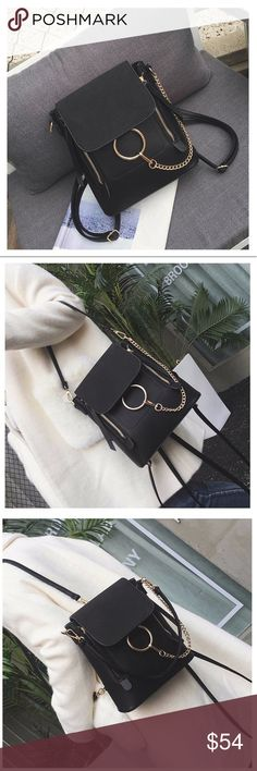 """Just In! 🆕 VERONA O Ring Chain Buckle Backpack Brand new. O Ring Chain Buckle Backpack. Can also be worn as shoulder or crossbody style! Vegan Leather. The top flap is textured faux suede material. Magnetic and zipper closure. 1 small zipper compartments and 2 small open compartments inside.  Adjustable straps  Approximately 9.5"""" x 10"""" x 3""""  Color - Black  Very well made. High quality boutique item. Last picture is for inside partitions references only. Bags Backpacks"""