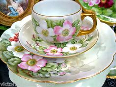 Tea: A hand-painted German floral trio of teacup, saucer, and plate, with gold accents.
