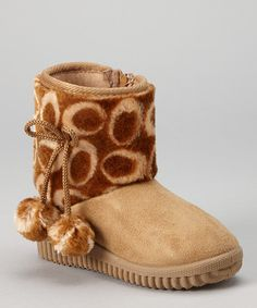 Finished with a pair of puffy pom-poms, these boots will perk up any gray day in a hurry! Fluffy flair aside, this toasty pair also boasts a sturdy sole and side zipper that makes them oh-so-easy to love.5'' shaft9.5'' circumferenceSample size Toddler 8Zipper closureMan-madeImported