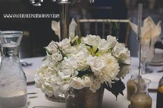 Picture was captured by Gage Blake Photography. Centerpiece created by La Boutique Nostalgie.