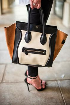 Stunning Leather bag with zipper and high black heels
