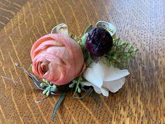 Burgundy, peach, coral,creams, ranunculus, roses