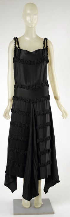 Evening dress Madeleine Vionnet (French, Chilleurs-aux-Bois 1876–1975 Paris) Date: fall/winter 1921–22 Culture: French Medium: silk Dimensions: Length at CB: 57 in. (144.8 cm) Credit Line: Gift of Madame Madeleine Vionnet, 1952 Accession Number: C.I.52.18.1
