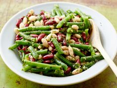 Three Bean Salad recipe - It's protein-packed and can be consumed cold, directly out of the fridge. Make it a meal or care package: Bring the salad with a bag of mixed greens, pita bread, and feta cheese for a delightfully fresh vegetarian protein packed sandwich.