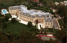 """AARON SPELLING'S HOME, VALUED AT MORE THAN $15M, IS SAID TO BE ONE OF THE MOST EXTRAVAGANT HOMES IN BEVERLY HILLS, CA.  THE HOUSE BOASTS A """"CHRISTMAS GIFT WRAPPING ROOM"""" AND A $50K COMPUTERIZED WARDROBE SYSTEM FOR DAUGHTER TORI SPELLING."""