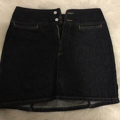 United Colors of Benetton Mini Skirt Denim Mini skirt, it has two small splits in the back, very tough material(cotton) Made in Italy, runs a little small, has small pockets perfect size for your lipgloss. Double buttons and zipper for closure.! Brand New! Open to offers! Skirts Mini