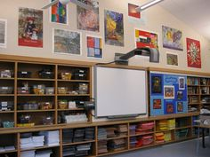 I LOVE all of the shelves and the moveable bulletin board!  Color-coordinated Construction Paper    name: Hannah Salia  school: St. Thomas School, K-6 independent school.  state: Washington    I was fortunate to be able to help design my art room when our new building (LEED certified) was built a few years ago.  This image shows my shelves of color-coordinated construction paper.