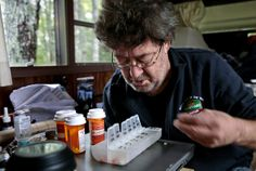 David Smith looks over his daily medications. He gets help with organizing his medicines when nurse Sally Patterson visits.   http://www.latimes.com/nation/la-na-healthcare-collaboration-20140319-dto,0,2911326.htmlstory#ixzz2wQjDqApp
