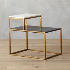 Shop 2 tone marble side table.   Clean lines and sleek metal meet the natural warmth of real marble for an eclectic modern mix.  Linear open frame in warm brass supports two marble shelves––one white, one grey.