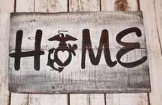 Official Hobbyist of the USMC License 17018 USMC Home Pallet Wood Sign. Home with the EGA having a heart in the center. This sign reminds us wherever our dwelling place happens to be, it is the people