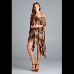 """Poncho Tunic Dress Boho leopard oversize top O/S Fabulous Boho Chic leopard rayon spandex stretch oversized Poncho / Tunic / Top / Dress  Loose fit, round neck, short poncho style tunic with asymmetrical hi lo hem  Made with drapy rayon spandex stretch lightweight jersey but not see-through can fall off the shoulder * one size for an Easy Fit New Without Tags  *  One Size Fits All  95% Rayon * 5% Spandex  *Machine Wash Cold  measures: 49"""" from side to side ( 98"""" around before stretching )…"""