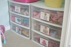 """Plastic drawer units to organize the main """"mess offenders"""" which have a lot of pieces & need a permanent home.  I hope that someday I can use our bedroom closets for toy storage."""
