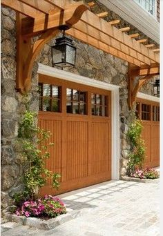Timber arbor overhang for beautiful accent over garage doors.