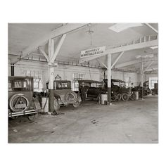 A mechanic with cars in the service area of an auto dealership. Rockville, Maryland. 1926.
