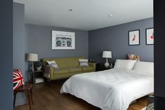 """Wide view of the peaceful master bedroom. The print above the sofa is by Lyle Owerko, """"Boombox at Clic Gallery."""""""