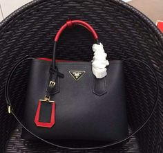 42972d7d67ed Prada bags Spring Summer Prada Prada Double Saffiano leather bag with two- tone handle red/black