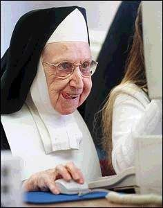 Nun learning the computer