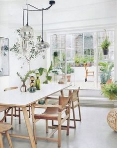 white and pale wood dining room