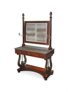 AN ITALIAN EMPIRE GRANITO MARBLE AND MAHOGANY DRESSING TABLE  CIRCA 1820