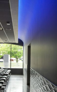 TPR Lights RGB LED cove lighting creating a color wash on a wall opposite hair salon wash bowls.