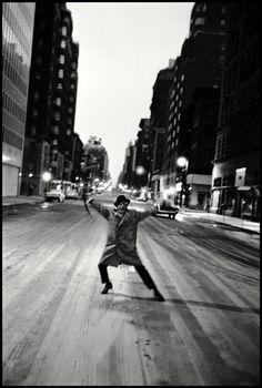New York. 1959. Sammy Davis Jr. dances across Madison Avenue after his last show at the Copa Cabana. By Burt Glinn