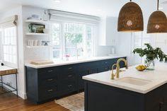 Benjamin Moore Hale Navy Cupboards & brass fixtures with open shelves by kitchen sink | Studio McGee