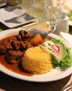 Seco de chivo or Ecuadorian braised goat stew meal at Hasta La Vuelta Señor restaurant in Quito, Ecuador.