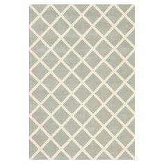 Wool rug with a lattice motif. Hand-tufted in India.   Product: RugConstruction Material: WoolColor: ...