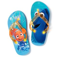 Finding Dory Light Up Flip Flops. Finding Dory themed light-up flip-flops..EVA/plastic, imported. Half sizes, order one size down. - Both flip flops are blue with orange straps.- Both have an ocean scene on the footbed, but one has a picture of Dory and the other has a picture of Nemo.- One light at each end of the strap (3 in total).- Lights cannot be replaced.