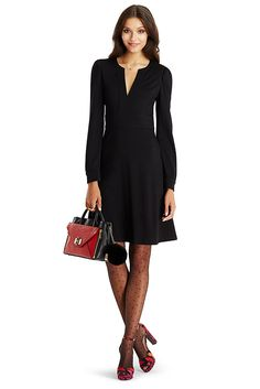 The DVF Leyah is a clean, feminine style in a jersey wool. With ruching at the shoulder, v-neck front with banded edge, easy flared skirt and side zip. Falls above the knee.