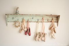 Distressed shelf with pointe shoes hanging