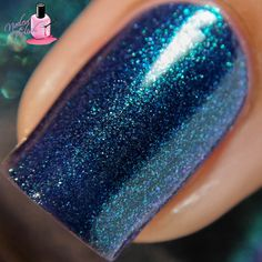 Grant - A deep navy to green duochrome with intense green shimmer. Swatch by @nailedthepolish on Instagram. Click on the photo to take you to the blog post.