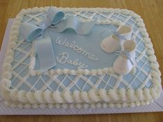 lemon cake with cream cheese buttercream frosting.  bow and baby booties are made of fondant/gumpaste mixture, dusted with luster dust.