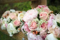 Pale pink peony bridal bouquet accompanied by light pink roses, Queen Anne's lace, peach hypericum berries, lisianthus and gypsophila!  Photo: www.olsonstudios.ca Bouquets: www.flowersbyjanie.com  #Reddeerweddingflorist #Calgaryweddingflorist #pinkpeonybridalbouquet #Queenanneslace #peonybouquets