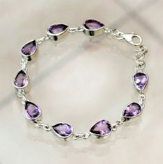 This amethyst Handmade Bracelet has been hand crafted with 9 sterling silver bezels,with a weight of 28.8 gms and carat value of 144cts   [$69.00]