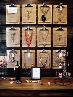 Clipboards As Jewelry Purveyor   lots of ideas here.  You could also paint with chalkboard paint and write prices on  them.