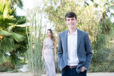 Groom in the foreground in focus and the bride out of focus in the background, engagement photo ideas in Palm Springs by Cavin Elizabeth Photography