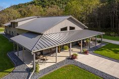 Lester Buildings Pole Barn Residence with Eclipse Metal Roof. Related prj: # 514688, 514726. Second level dimension: 36' x 96' x 17'. Wainscot in Quaker Gray, roof is Eclipse in Quaker Gray with 5/12 & 3/12 roof pitches, windows by others, Clopay overhead door, AJ door, and doors by others, mansard roof, wrap around porch, concrete floor, radiant hear, liner by Lester. #polebarn #home #house #metalroof #design #ideas