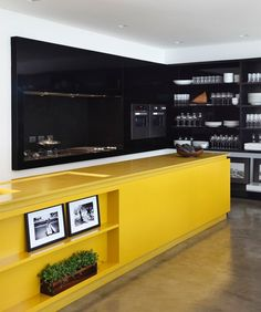 I love the yellow countertop - what a contrast to the black surrounding it!   Studio Guilherme Torres designed the LA House in Londrina, Brazil.