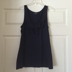 Navy blue tank top Navy blue tank/sleeveless top. Ruffles on front. Please feel free to ask any questions or if you would like additional photos. Also, please feel free to make an offer! I will not be offended and you may be pleasantly surprised! Happy Poshing! Express Tops