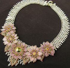 "Miriam Garden Bloom Necklace ""Kim Anderson taught me to make these beautiful flowers. :D"" Some of the most fabulous beadwork I've ever seen on her photo stream Beaded Jewelry Designs, Bead Jewellery, Necklace Designs, Handmade Jewelry, Seed Bead Flowers, Beaded Flowers, Bridal Necklace, Collar Necklace, Statement Jewelry"