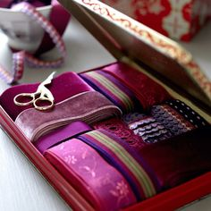 keep ribbon in old tins or boxes