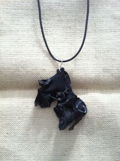 Necklace made with pieces of old records http://melylefay.wix.com/avaloncreations